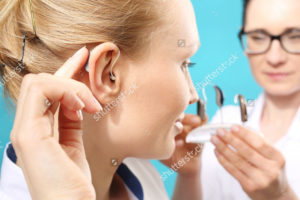 stock-photo-hearing-aid-the-doctor-assumes-the-woman-hearing-aid-in-your-ear-430293268